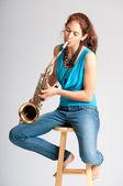 Beautiful young woman saxophone player — Stock Photo