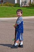 Little boy with skateboard — Stock Photo