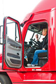 Blonde woman truck driver — Stockfoto