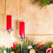 Stock Photo: Candles and Christmas decorations on fireplace mantle