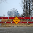 Dead end sign and barricade - Stock Photo