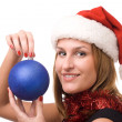 Smiling women holding christmas toy - Stockfoto