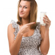 Young woman holding glass of milk in hand — Stock Photo