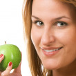 Smiling woman holding green apple — Stock Photo