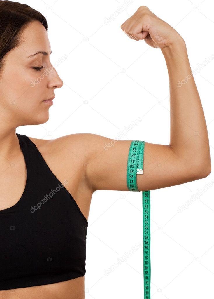 woman measuring her arm stock photo vankad 4772317. Black Bedroom Furniture Sets. Home Design Ideas