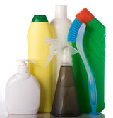 Bottles with washing liquids and cleaning brush — Stock Photo