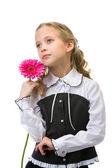Portrait of a young beautiful girl with flower — Stock Photo