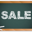 Sale written on blackboard with chalk. — Vector de stock #4149884
