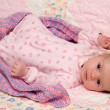 Baby Girl Lying on Blanket - Stock Photo