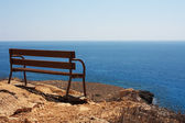Bench by the sea — Stok fotoğraf