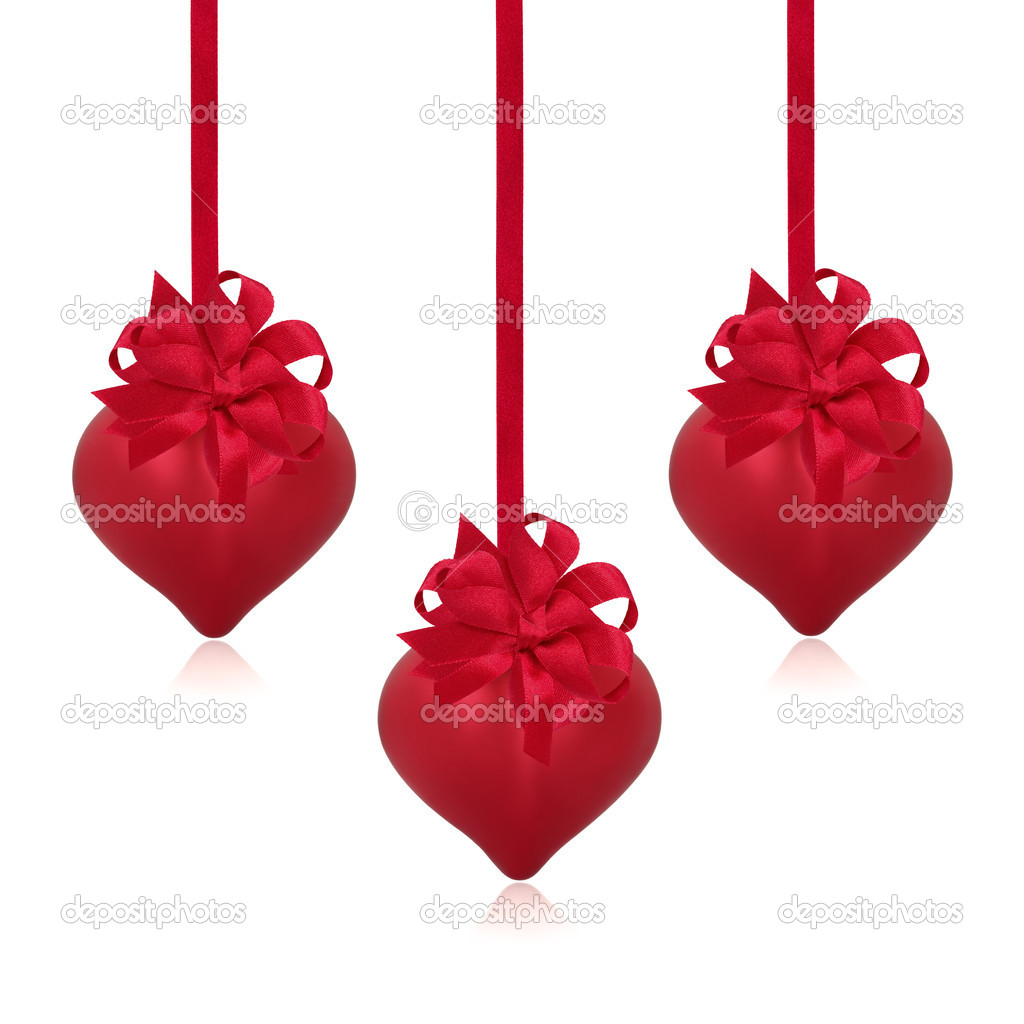 Red valentine heart baubles with satin ribbon and bow arranged in abstract design isolated over white background.  Stock Photo #4400278