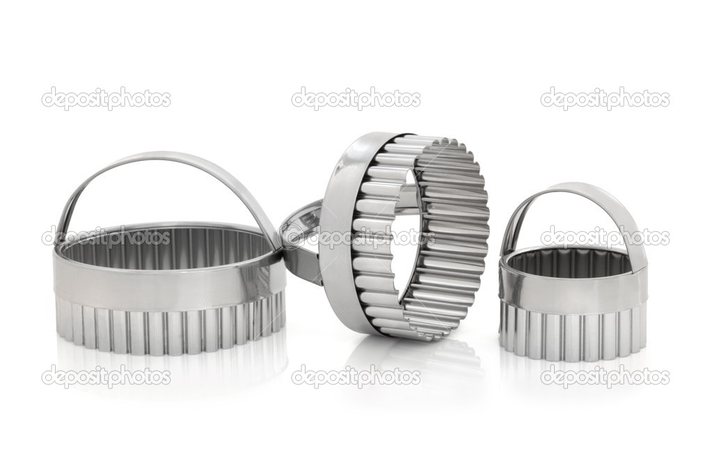 Chrome cookie cutters set, over a white background.  Stock Photo #4405894