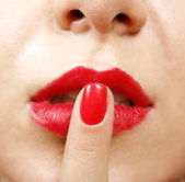 Finger on lips — Stock Photo
