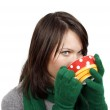 Woman drinking a hot beverage — Stock Photo