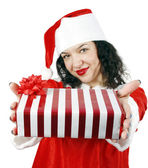 Young woman giving a gift — Stock Photo