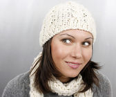 Woman in cap and scarf — Stock Photo