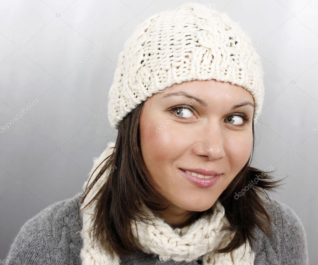 Beautiful woman in cap and scarf  — Stock Photo #4479341