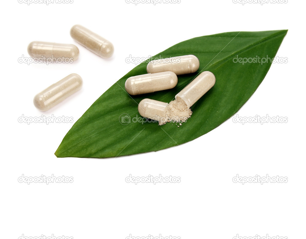 Natural pills and a green leaf — Stock Photo #4500353