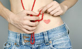 Woman with heart shape on her belly — Stockfoto