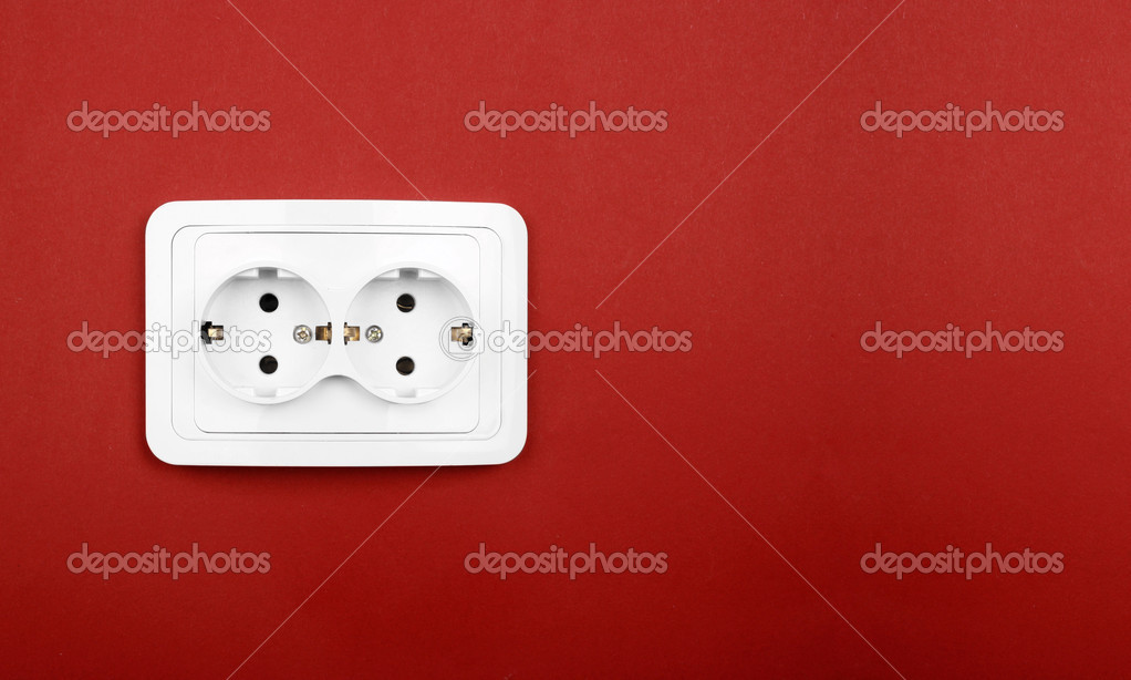 Power outlet on red wall  Stock Photo #4943974