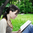Young woman reading a novel — Stock Photo #5016430