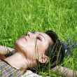Woman lying on the grass in the park — Stock Photo #5271137