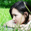 Young female lying on the grass — Stock Photo #5291084