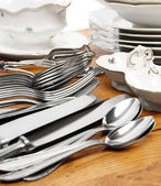 Dishes and cutlery set — Stock Photo