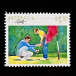 Royalty-Free Stock Photo: Vintage postage stamp of young boy being taught how to play golf with clipp