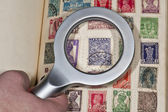 Philatelist browsing their vintage stamps of India — Stock Photo