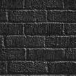 Black painted brick wall — Stock Photo #5343584