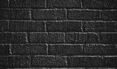 Black painted brick wall — Stock Photo