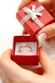 Gold diamond ring in a red box — Stock Photo