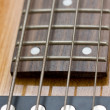 Four strings bass guitar closeup - Stock Photo