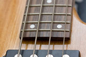 Four strings bass guitar closeup — Stock Photo