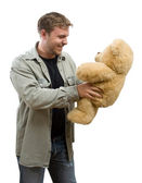 Man with teddy bear — Stock Photo