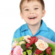 Stock Photo: One boy with bouquet of flower