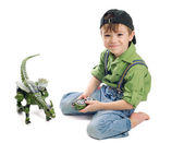Young boy playing with dinosaur — Stock Photo