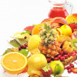Fresh fruits and red juice — Stock Photo