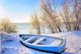 Blue boat near danube river — Stock Photo
