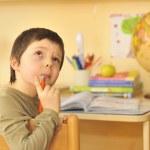 Boy doing homework — Stock Photo #3965987