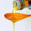 Olive Oil pouring from a bottle — Stock Photo #4014920