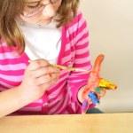 Girl painting her hand — Stock Photo