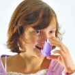 Girl using inhaler — Stock Photo