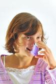 Girl using inhaler — Stock Photo