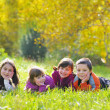 Little boys and girls laying down on grass — Stock Photo #4134096