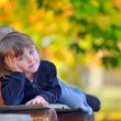 Stock Photo: Little girl laying down on bench