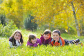 Little boys and girls laying down on grass — Stock Photo