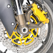 Closeup detail of a motorcycle's front wheel — Foto Stock #4176973