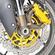 Closeup detail of a motorcycle's front wheel — Stock Photo #4176973